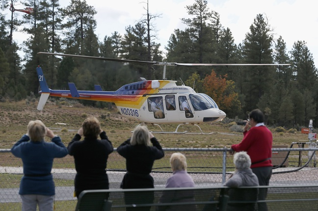 Hundreds of tourists flock to Grand Canyon Airport to take helicopter and plane tours as the only way they could see the Grand Canyon as the entrance to Grand Canyon National Park remains closed to visitors due to the continued federal government shutdown on Friday Oct. 11, 2013, in Tusayan, Ariz.