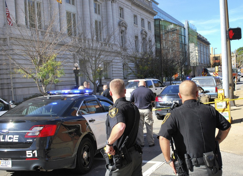 Local law enforcement officers secure an area in front of the Federal Buildng in Wheeling, W.Va., Wedneday following a shooting outside the courthouse.