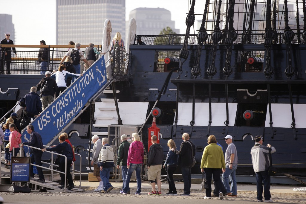 Visitors to the USS Constitution, the oldest ship in the U.S. Navy, line up to walk up the gang plank for a tour in Boston on Thursday. Federal memorials and National Park Service sites opened, and thousands of furloughed federal workers returned to work Thursday after 16 days off the job due to the partial government shutdown.