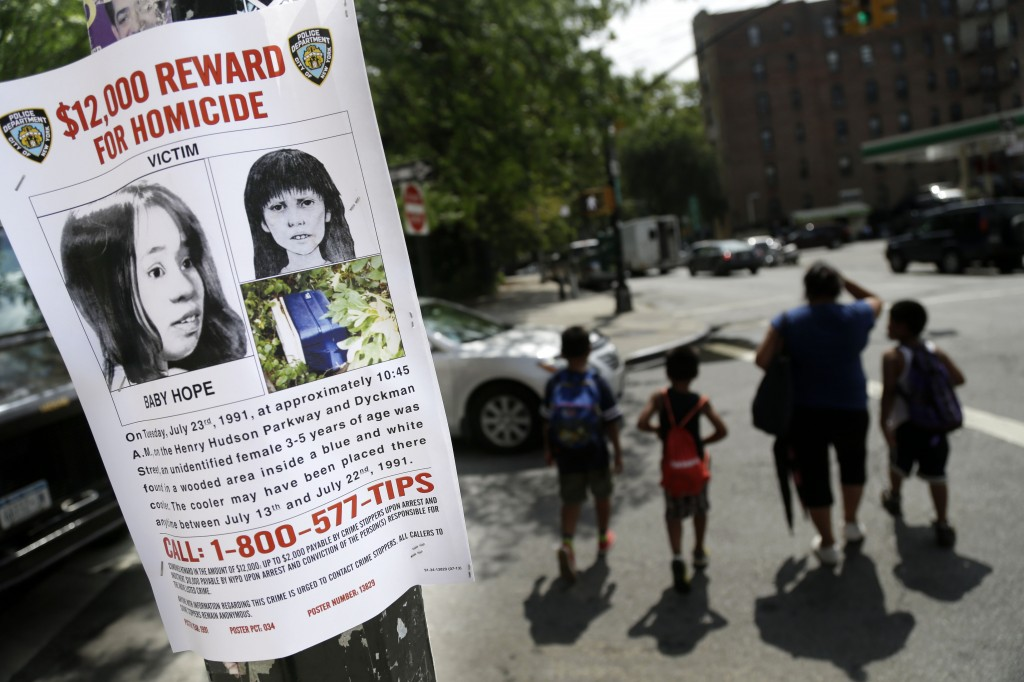A poster solicits information regarding an unidentified body near the site where the body was found in New York. Police in New York City said Saturday that they had arrested the killer of a child who was nicknamed Baby Hope by detectives after her body was discovered inside a picnic cooler beside a Manhattan highway in 1991.
