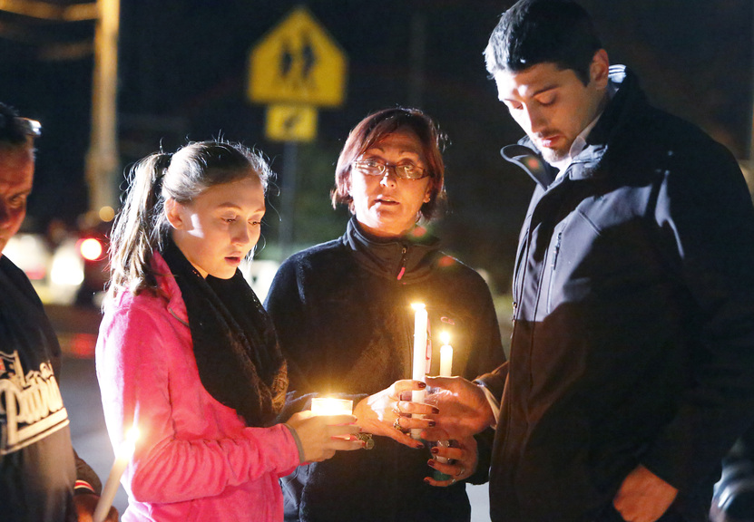 Parents and Danvers High School students hold candlelight vigil to mourn the death of Colleen Ritzer, a 24-year-old math teacher at Danvers High School, on Wednesday, Oct 23, 2013, in Danvers, Mass. Ritzer's body was found in woods behind the school, and Danvers High School student Philip Chism, 14, who was found walking along a state highway overnight, was charged with killing her.