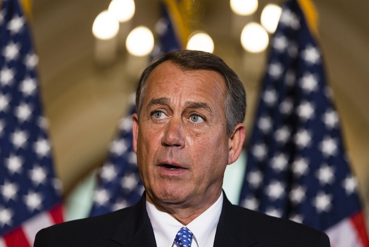 """As the government shutdown continues into a second week with no end in sight, Speaker of the House John Boehner, R-Ohio, makes a statement outside his office Tuesday to respond to President Obama's statements at a news conference. Obama said he told Boehner that he's willing to negotiate with Republicans on their priorities, but not under the threat of """"economic chaos."""""""