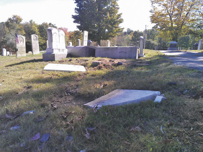 Police say Melissa Grant, 42, and Savannah Lowe, 20, both of Winthrop, caused an estimated $35,000 of damage to headstones in Monmouth Ridge Cemetery on Friday.