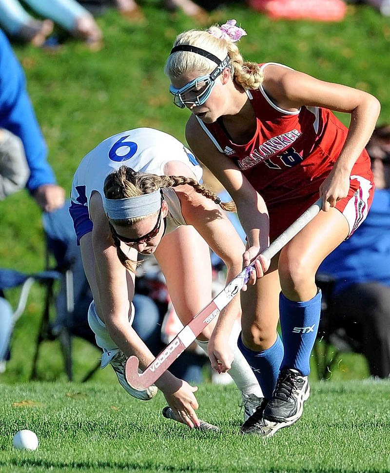 ALL-OUT EFFORT: Lawrence's Lilla Tilton-Flood, left, battles for the ball with Messalonskee's Nathalie St. Pierre during the Eagles' 4-0 win Tuesday at Lawrence High School in Fairfield.