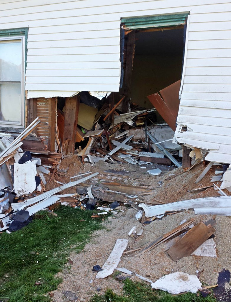 An Oldsmobile crashed through a Belgrade home on Knowles Road late Thursday night. No serious injuries were immediately reported.