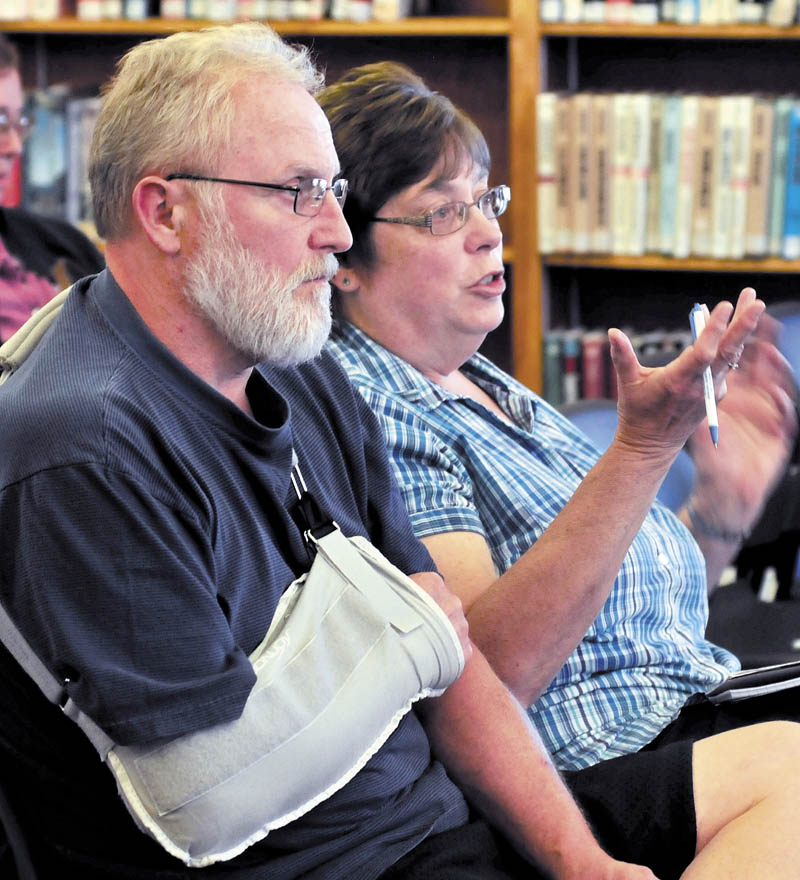 Brenda Lint asks questions during a presentation on the Affordable Care Act today at the Waterville Public Library. Her husband, Mark, is seated to her right.
