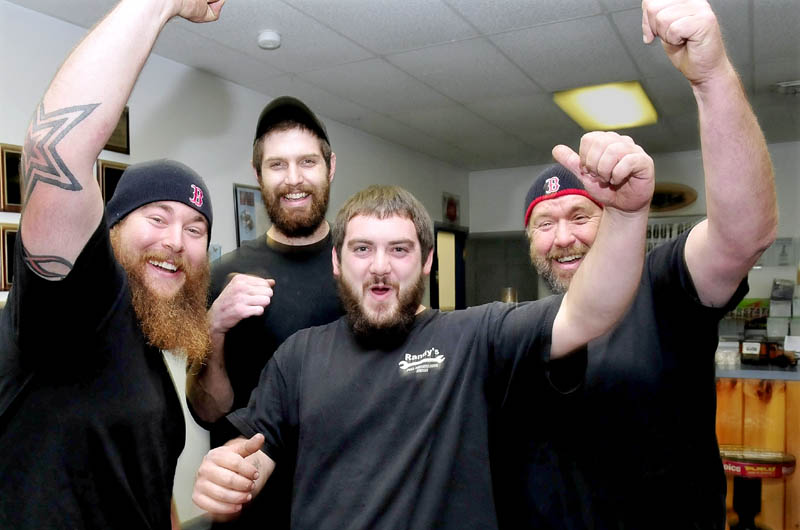 Red Sox baseball team fans whoop it up while talking about the prospects of the team winning the World Series that begins Wednesday while at Randy's Auto Repair in Skowhegan on Tuesday. From left are Mike Bruce, Dylan Adam, Quentin Frigon and Randy Bruce.