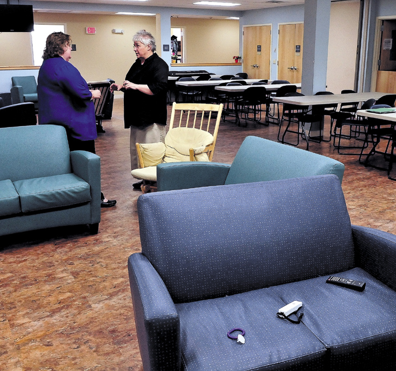 Mid-Maine Homeless Shelter Executive Director Betty Palmer, left, and Shelter Volunteer Coordinator Sheila Bacon confer in the multi-purpose room at the Waterville facility on Tuesday.