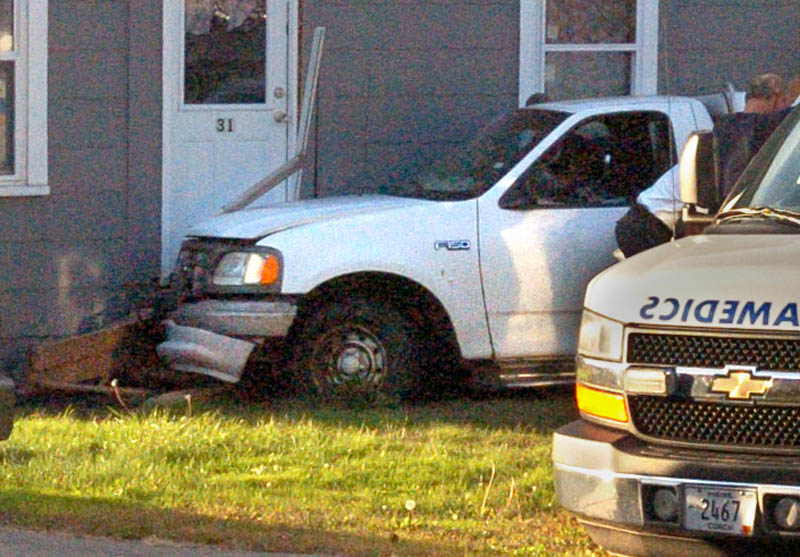 One man was taken to the hospital after the car he was driving veered off Bay Street and into a house in Winslow Friday.