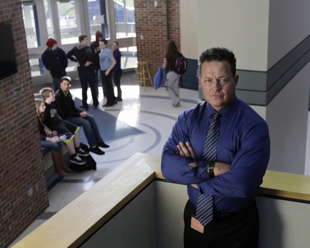"""Columbia High School Principal John Sawchuk poses at the school recently in East Greenbush, N.Y. In 2004 Sawchuk found himself wrestling a 16-year-old student for the loaded shotgun the boy used to wound a teacher. """"That was the most terrifying moment of my life, something I will never forget,"""" Sawchuk said. """"I kept thinking, if I let go, he's going to kill me."""""""