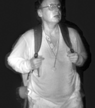 Legand: A 2011 surveillance photo shows Christopher Knight during a camp burglary. Knight, whose name was not known at the time, was called the North Pond Hermit by some burglarized camp owners.