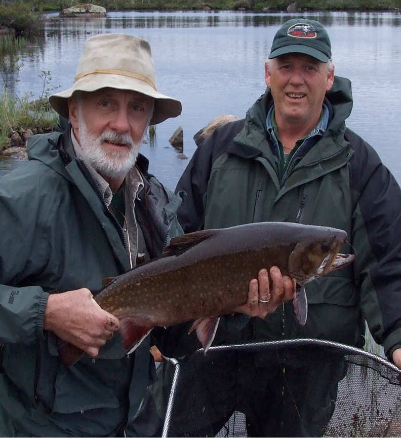 BIG CATCH: Carroll Ware, left, of Skowhegan holds up a 10-pound brook trout he caught recently. Ware holds 31 certified fishing world records and would like push that number to 50.