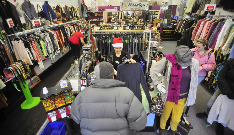 BLACK FRIDAY: Melissa Holmwood, facing center, owner of Madlyn's New and Used Consignment Shop in Waterville, helps a customer during the Black Friday sale in Waterville on Friday morning.