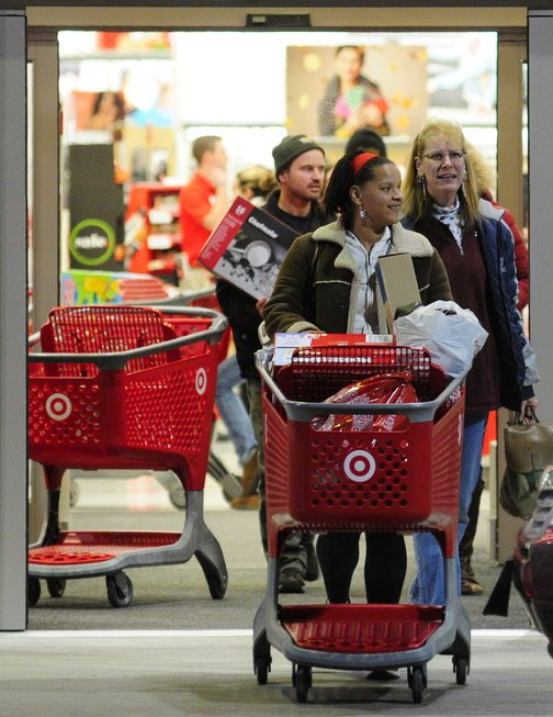 Black FRIDAY: Shoppers roll carts out the Target store during early morning Black Friday shopping at 5:07 a.m. Friday in Augusta.