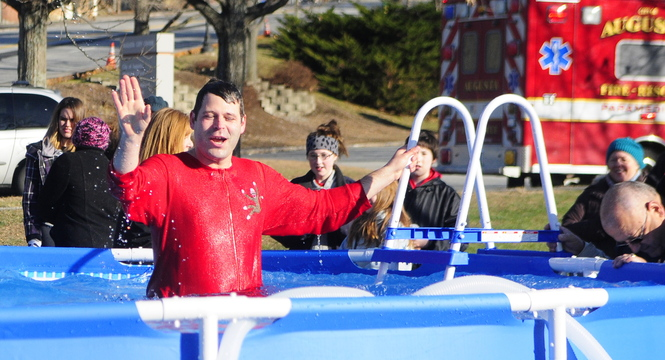 Enough of this: Tobias Parkhurst climbs out of the pool Saturday at the Polar Bear Plunge fundraiser at Old Fort Western in Augusta. The proceeds are meant to support the city's Bicentennial Nature Park.