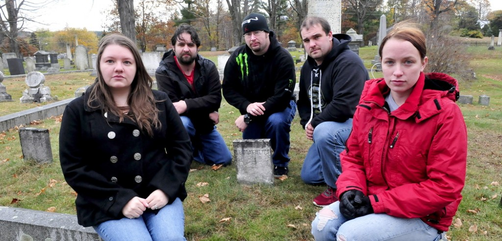 SPIRITED: Members of Paranormal Research and Extermination assemble at the Edward E. Mathew gravesite at Pine Grove Cemetery in Waterville recently. The group is trying to record the spirit of Mathews, who was the first murder victim in Waterville in 1847. From left are Naomi and Kris Robinson, Jim Easler, Chris Clarke and Allie Turner.