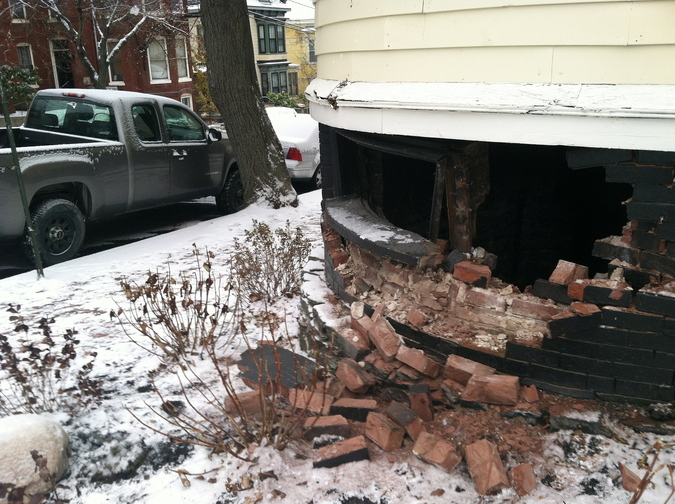 A car slid into a house at Mellen Street and Cumberland Avenue in Portland's Parkside neighborhood, smashing a hole in the brick foundation, on Tuesday.