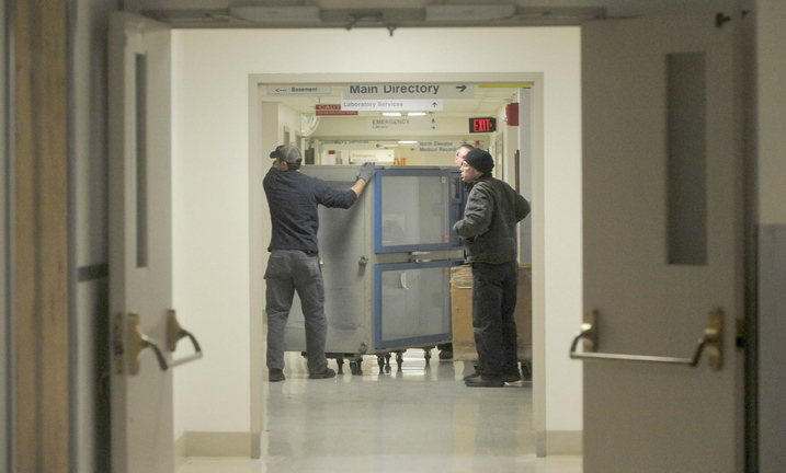 MOVING: Workers move equipment as a $16 million renovation project begins at Thayer Center for Health in Waterville.
