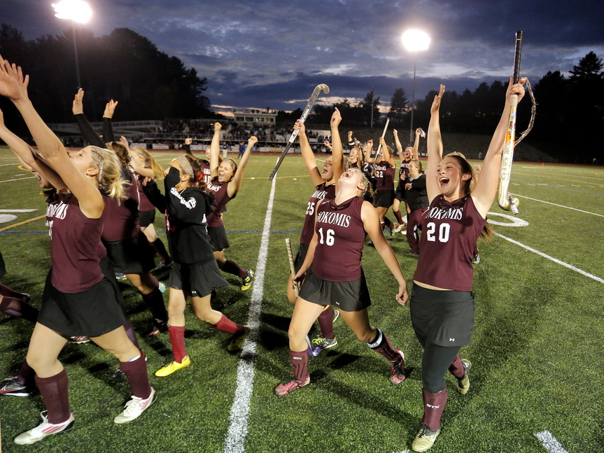 WINNERS: Nokomis celebrates its victory over York in the Class B field hockey championship game Saturday at Yarmouth High School.