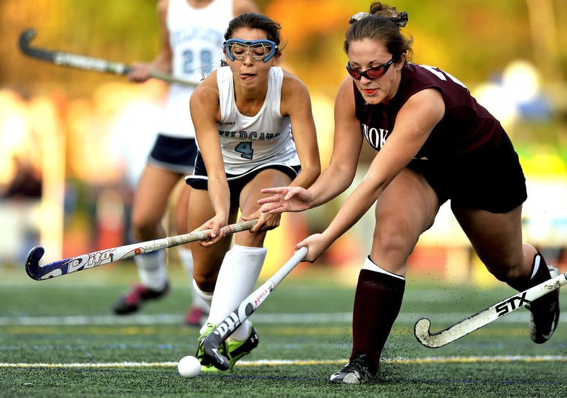 BATTLE FOR THE BALL: York's Kayle Kelly, left, competes for the ball with Mikayla Charters of Nokomis, right, uring the Class B field hockey championship game Saturday at Yarmouth High School.