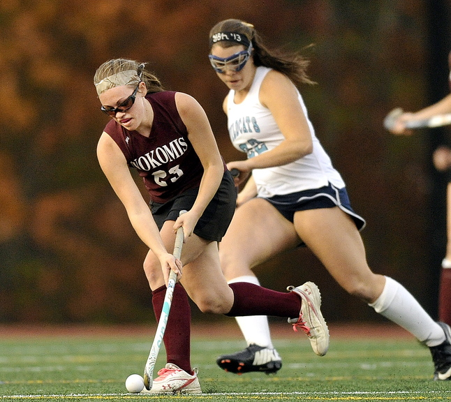 ON THE MOVE: Taylor Shaw of Nokomis moves with the ball in front of York's Madeline Leroux during first half action in the Class B field hockey championship game Saturday at Yarmouth High School.