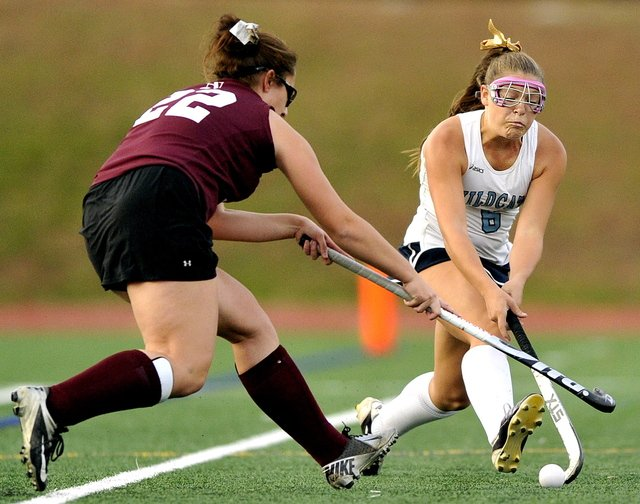 TAKE IT AWAY: Mikayla Charters of Nokomis uses her stick to try to steal the ball away from Alexandra Jones of York during the Class B field hockey state championship at Yarmouth High School.