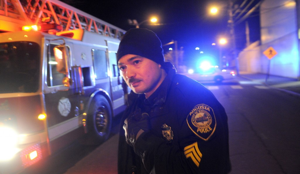 FAILED TEST: Augusta Police Dept. Sgt. Vincente Morris looks down Arsenal Street after the street buckled Tuesday night above a natural gas pipeline, resulting in evacuations of nearby residents. Authorities determined that air in a Summit Natural Gas of Maine pipeline erupted during a pressure test.