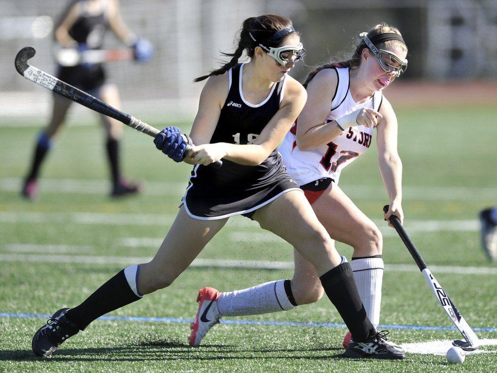 TAKE A SHOT: Skowhegan's Haley Thebarge, left, competes with Scarborough's Maggie Carbin for control of the ball in second half of the Indians' 4-1 win in the Class A state championship game Saturday at Yarmouth High School.