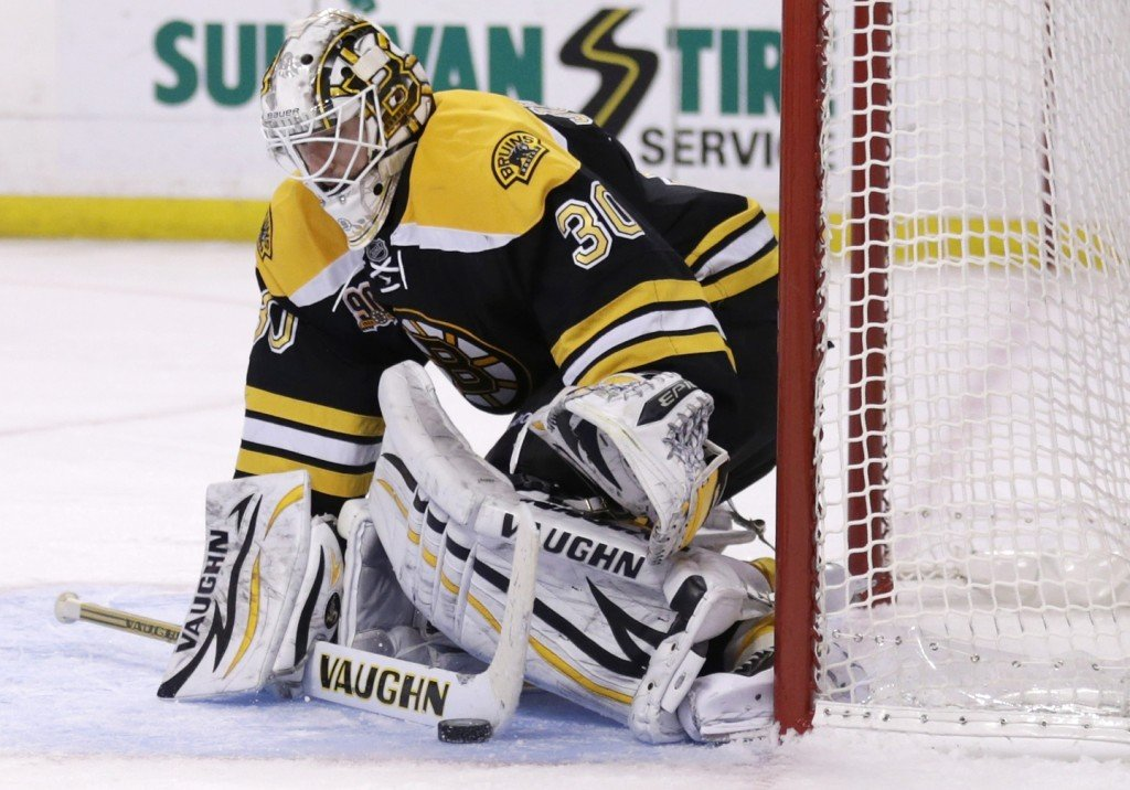 Boston Bruins goalie Chad Johnson (30) makes a stick save against the Columbus Blue Jackets during the third period of an NHL hockey game, in Boston, Thursday, Nov. 14, 2013. The Bruins won 3-2 in overtime. (AP Photo/Charles Krupa)