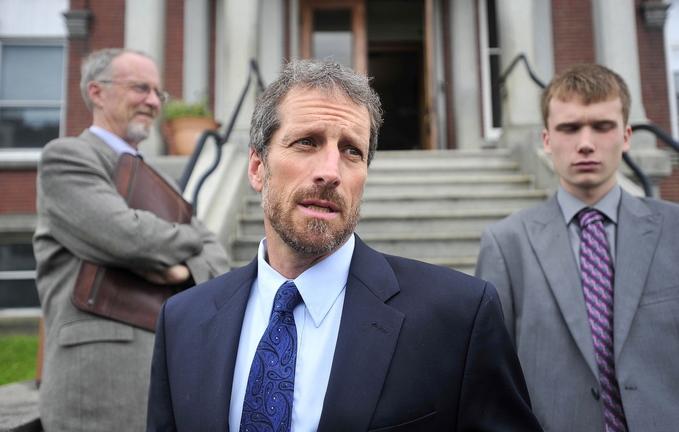 Defense: Phil Mohlar, center, attorney for Jason C. Cote, 22.