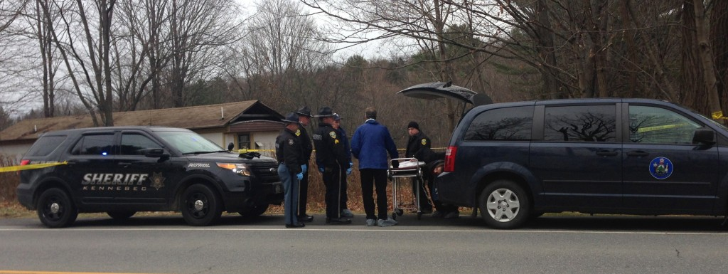Suspicious Death: Officials prepare to remove the body of a man found dead Friday morning in a residence on U.S. Route 201 in Vassalboro.