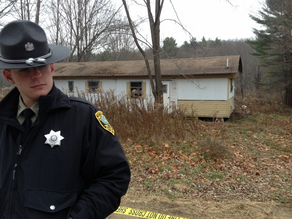 Vassalboro Death: Kennebec Sheriff's Deputy Aaron Moody guards a trailer in Vassalboro Friday morning where there was a report of a suspicious death.
