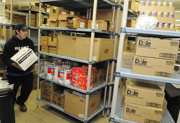 Scott Gayne moves boxes in the food service storage area on Friday at the Alfond Center for Health in Augusta.