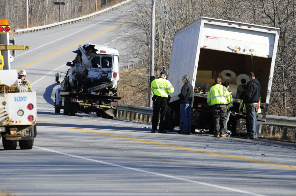 Emergency crews work at the scene of a collision between a conversion van and a panel truck near intersection of U.S. Route 202 and Royal Street on Thursday November 21, 2013 in Winthrop. State Police troopers were using surveying equipment as part of their reconstructing the accident scene.