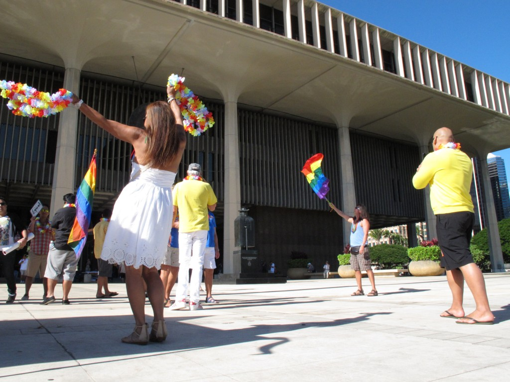 Gay marriage supporters rally outside the Hawaii Capitol in Honolulu ahead of a Senate vote on whether to legalize same-sex marriage on Tuesday.
