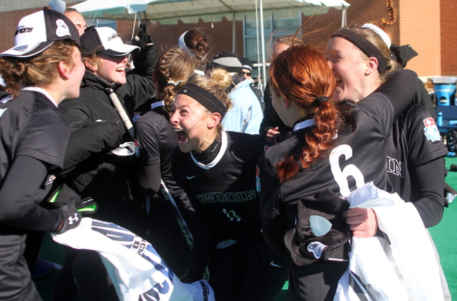 Molly Paduda, 11, celebrates with teammates after Bowdoin won the NCAA Division III field hockey championship with Sunday's 1-0 win over Salisbury University at Norfolk, Va.
