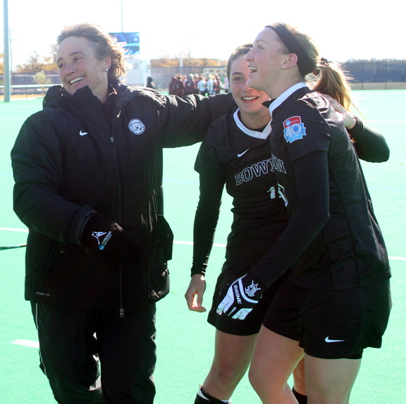 Bowdoin celebrates their NCAA Division III championship against Salisbury State. Bowdoin won 1-0 in Norfolk, Va. On the left is coach Nicky Pearson, followed by Rachel Kennedy (18) and Colleen Finnerty (13).