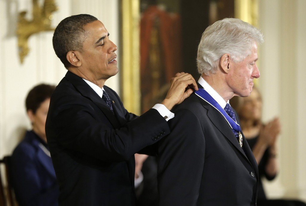 President Barack Obama awards former President Bill Clinton the Presidential Medal of Freedom on Wednesday during a ceremony in the East Room of the White House.