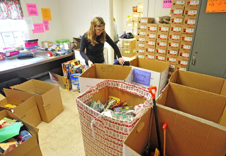 HOLIDAY HELP: Dawn Lincoln, of Linconville, volunteers her time to pack holiday gift boxes for poor children in the area at the Maine Children's Home for Little Wanderers.