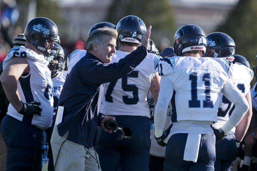 Maine Coach Jack Cosgrove pats the shoulder of Maine wide receiver John Ebeling in Saturday's loss to New Hampshire. The Black Bears received a firt-round bye in the Football Championship Subdivision playoffs and will be home for a playoff game for the first time on Dec. 7.