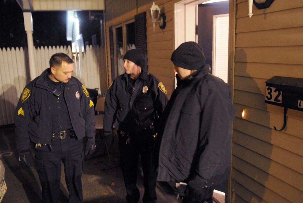 Augusta Police patrolmen Sgt. Vincente Morris, left, Officer Carly Smith and Officer Laura Drouin confer Wednesday evening outside of an apartment at 32 Crosby Street in Augusta after a deceased woman was discovered inside the first floor unit just after 8 p.m. A man also found inside the apartment was transported to the hospital with injuries, police said. State Police detectives from the Major Crimes Unit took charge of the investigation that authorities characterized as a suspicious death. Chief Medical Examiner Dr. Margaret Greenwald arrived at midnight to determine a cause of death, according to authorities.