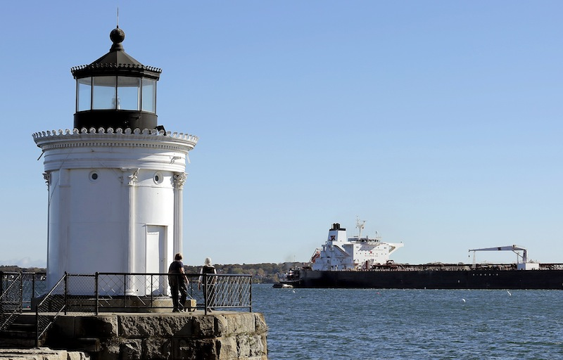 In this Oct. 18 file photo, the oil tanker Gagnes Spirit jockeys for position with the help of a couple of tugboats at the Portland Pipeline Corporation dock just behind Bug Light in South Portland. If South Portland voters approve the controversial Waterfront Protection Ordinance on the city ballot Tuesday, the law will likely end up in court, lawyers and city officials say.