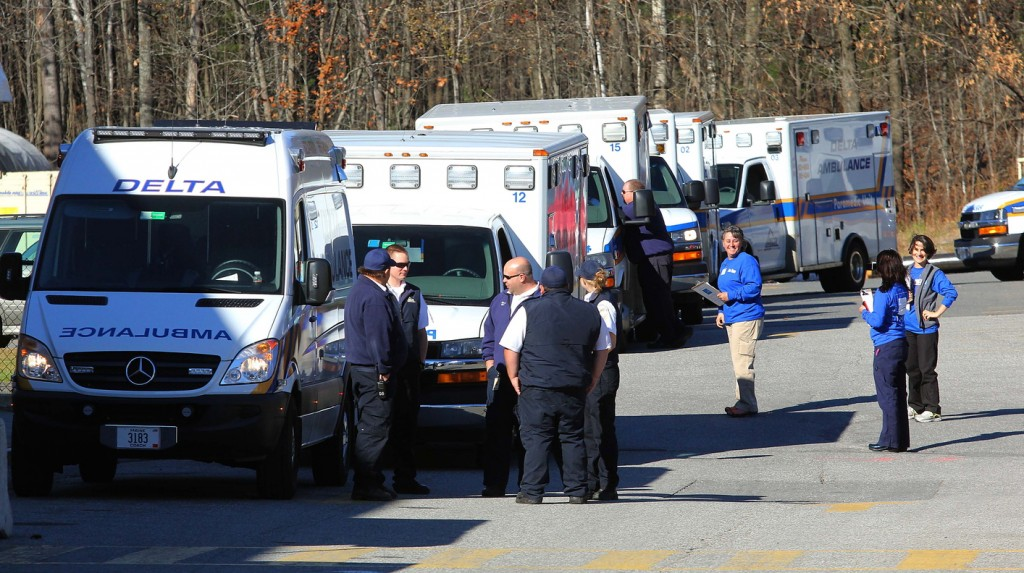 Photo by Jeff Pouland ABOUT TO MOVE: Ambulance crews wait to receive patients outside the Thayer Center for Health in Waterville on Saturday before transporting them to the new Alfond Center for Health in Augusta. The Thayer Center for Health will remain open as an outpatient facility with a 24-hour emergency department.