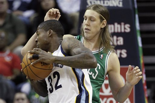 Boston Celtics' Kelly Olynyk, of Canada, right, defends against Memphis Grizzlies' Ed Davis (32) in the first quarter of an NBA basketball game in Memphis, Tenn., Monday, Nov. 4, 2013. (AP Photo/Danny Johnston)