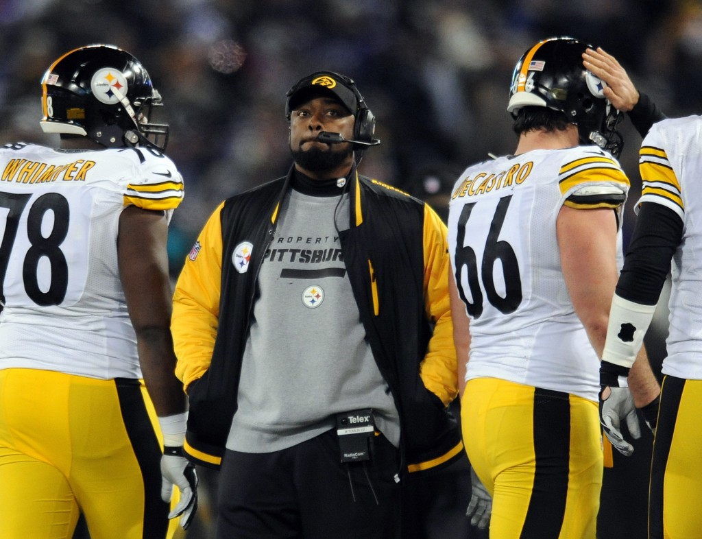 """FILE - In this Nov. 28, 2013 file photo, Pittsburgh Steelers coach Mike Tomlin stands on the sideline during an official play review in the second half of an NFL football game against the Baltimore Ravens, in Baltimore. Tomlin has been fined $100,000 for interfering with a play against the Baltimore Ravens on Thanksgiving. The NFL also said Wednesday, Dev. 4, 2013, that it would consider docking Pittsburgh a draft pick """"because the conduct affected a play on the field."""""""
