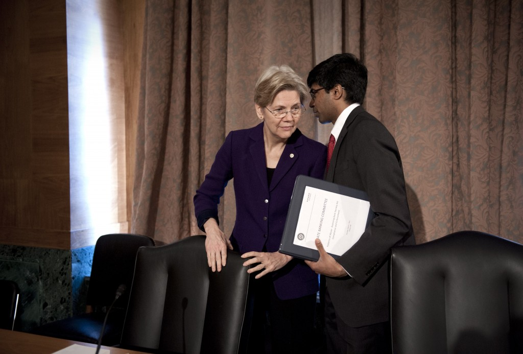 U.S. Sen. Elizabeth Warren, D-Mass., confers with Ganesh Sitarama, her senior counsel, after attending a Senate Banking Committee hearing on anti-money laundering in March. She said Wednesday that she will not run for president in 2016.