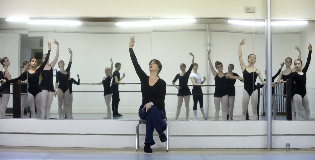 """BOSSOV BALLET: Natalya Getman, center, instructs the ballerinas with the Bossov Ballet Theatre during a rehearsal at Maine Central Institute in Pittsfield on Thursday. MCI now oversees the company since founders Andrei Bossov have returned to Russia. Getman, who has choreographed many Bossov and Opera House productions, is the company's artistic director of Bossov. The Bossov Ballet will be performing """"The Nutcracker"""" this month at the Waterville Opera House."""