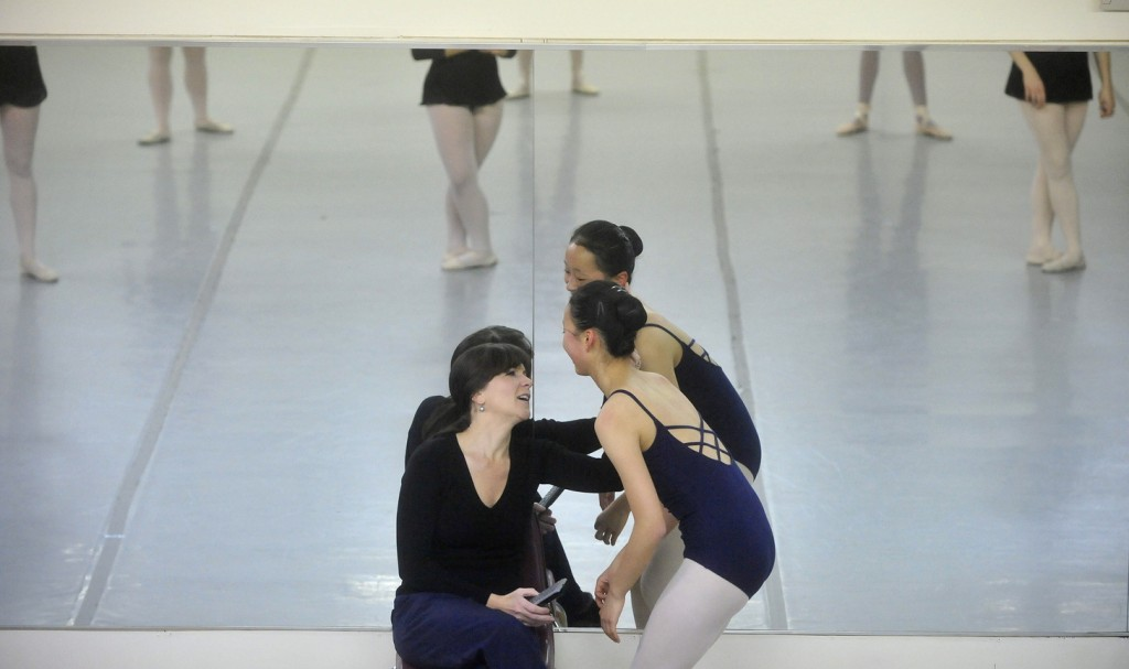 """BOSSOV BALLET: Natalya Getman, left, shares a moment with Maine Central Institue sophomore Diyun Wang, 16, during a rehearsal for """"The Nutcracker"""" last week. The Bossov Ballet Theatre is now a part of the Pittsfield school. Getman is the company's new artistic director, succeeding Andrei Bossov."""