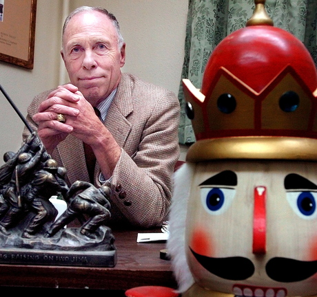 NEW DIRECTION: Retired U.S. Marine Col. Micheal Wyly, founder of the Bossov Ballet Theatre, in his office in Pittsfield with mementoes of his two careers.
