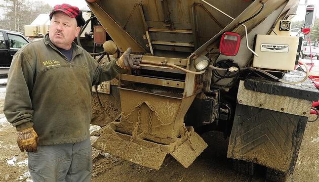 Winning bidDer: Chris Ellis talks about the calcium chloride dispensers on his plow trucks on Tuesday at Ellis Construction in Farmingdale.